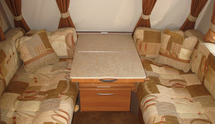 The generous front lounge in the 2009 Swift Charisma 565, reviewed by Practical Caravan