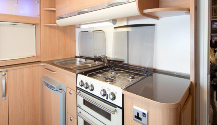 The kitchen area is well lit and well equipped