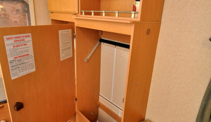 Wardrobe has just about enough hanging space for two in the Gobur Carousel Slimline 10/2 folding caravan