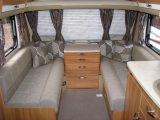 Front lounge in the 2013 Swift Conqueror 645, reviewed by Practical Caravan