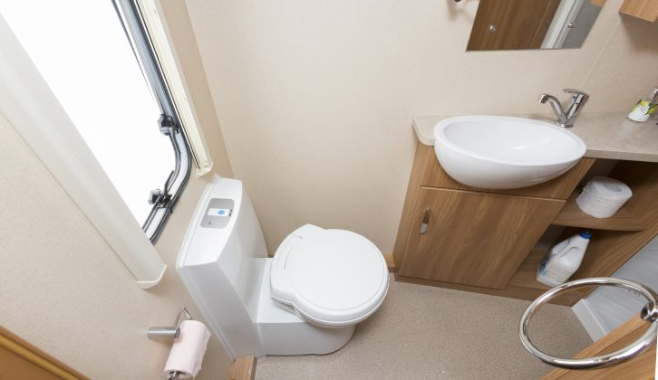 There is plenty of legroom by the swivel toilet, while a towel ring and coat hook are welcome