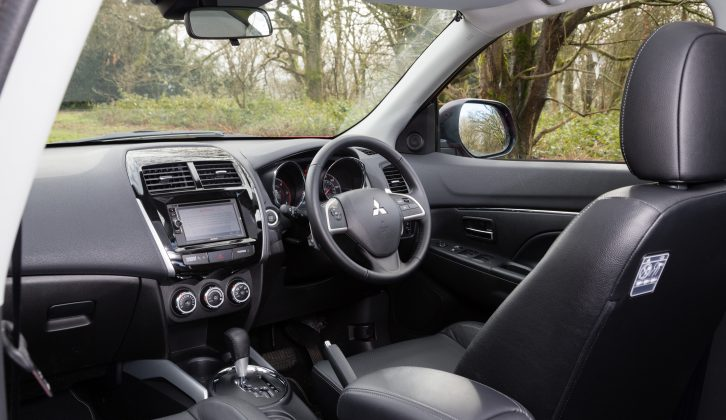 Even with the seat on its lowest setting, the driver sits high in the Mitsubishi ASX, Practical Caravan's reviewers say, but cabin space is respectable