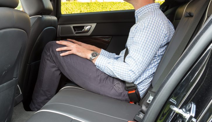 Three can fit in the rear seat of the Jaguar XF Sportbrake, but the transmission tunnel makes it better suited to two, while leg and headroom are limited, say Practical Caravan's testers