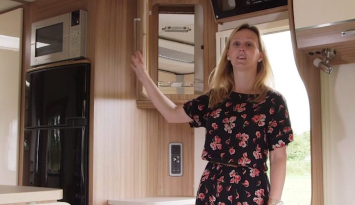 Practical Caravan's Stacie Pardoe shows you round the luxurious rear transverse island bed caravan from Lunar, the Delta TI, and finds a cocktail cabinet!