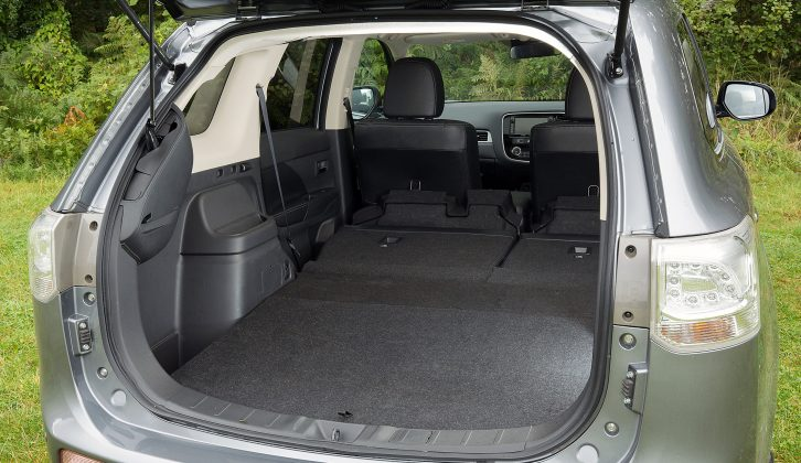 To extend the load space in the Mitsubishi Outlander PHEV, you must first tip the seat bases forward, but the seats do lie flat