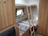 With its side dinette turning into bunk beds (lower 0.7m x 1.8m; upper 0.58m x 1.8m), the Elddis Sanremo 304 dealer special from Venture Caravans is a family-friendly four-berth