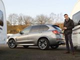 The 3.0-litre six-cylinder engine under the bonnet of this BMW X5 gives great performance when towing – tune in for our full review
