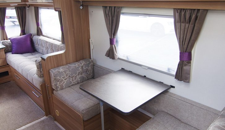 Children love having a side dinette in the family caravan and quickly turn it into their play area for games or drawing