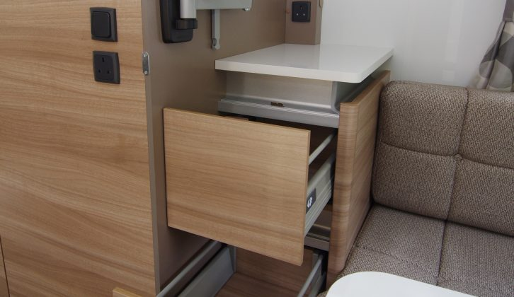 A TV bracket, sockets and storage have thoughtfully been fitted in the rear lounge