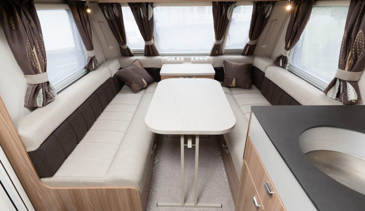 In the 2016 Swift Conqueror 565 there are twin fixed singles at the rear and a two-tone lounge