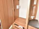 The wardrobe has useful drawers beneath the hanging space