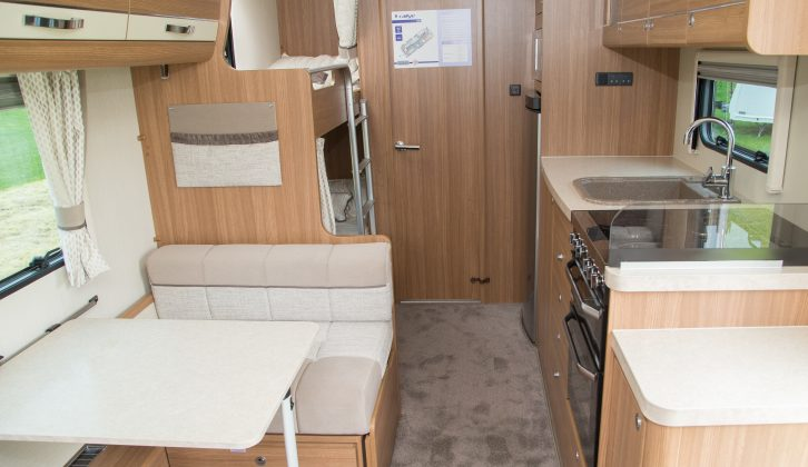 Beyond the dinette are the bunks and the end washroom – note the cosy carpet underfoot