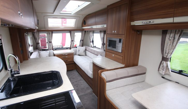 In this van, which has an internal length of 5.51m, you get a front lounge, a side dinette with kitchen opposite, and an end washroom