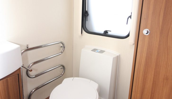 There's a Thetford electric flush toilet with yet more storage above in the 530's end washroom