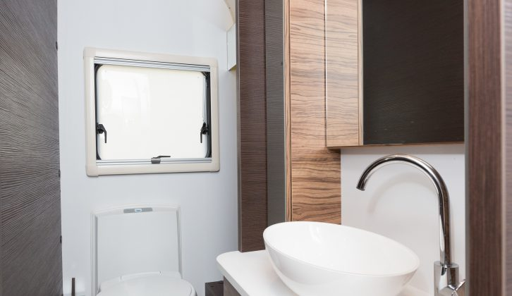 There's a Thetford loo, a bowl sink with a chrome mixer tap and a chic finish in the end washroom – read more in the Practical Caravan Adria Astella 613HT Amazon review