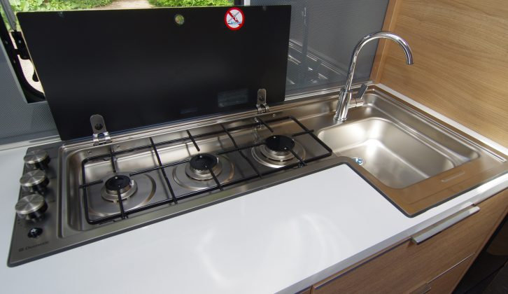The clever design of the three-burner hob means that spillages drain straight into the sink