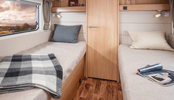 Buy the Knaus StarClass 565 and get twin fixed singles, each with a window, a shelf and a reading light