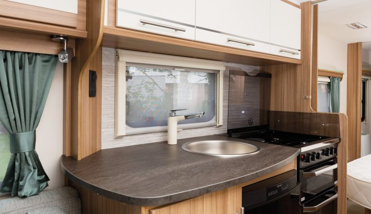 The Lunar Quasar 574's light, airy kitchen has a good worktop space beside the sink as well as on the dresser opposite