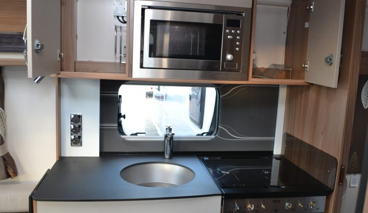The microwave is quite high, but we like the smart tap and splashback, plus those cupboards