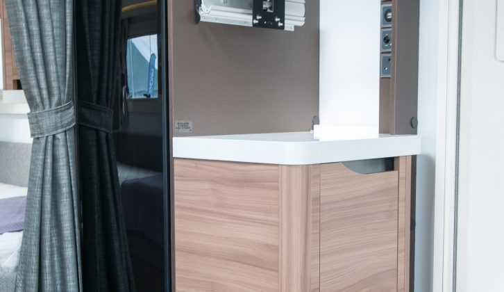 A 140-litre slimline fridge sits opposite the main kitchen, with additional worktop space next to it