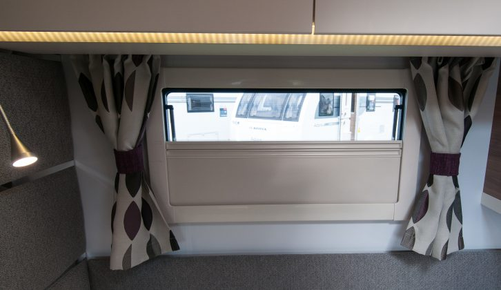 Each bed has a window (with a curtain, flyscreen and blind) and a reading light
