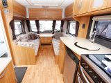 The centre chest, with its occasional table, offers a practical dining option for couples in the Lunar caravan