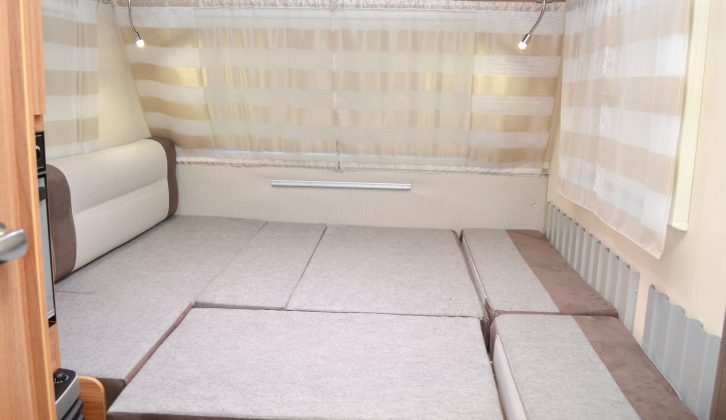 Need more space? The addition of a couple of boards and the remaining seats creates a larger double bed