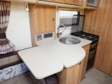 The kitchen is well-equipped and there's a flap to extend food prep space – read more in the Practical Caravan Bailey Unicorn Pamplona review