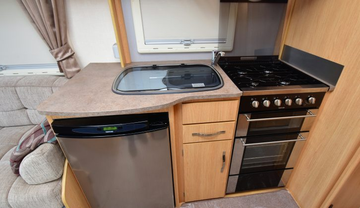 The Thetford fridge is digital and the oven is topped by a four-burner hob, with a microwave overhead