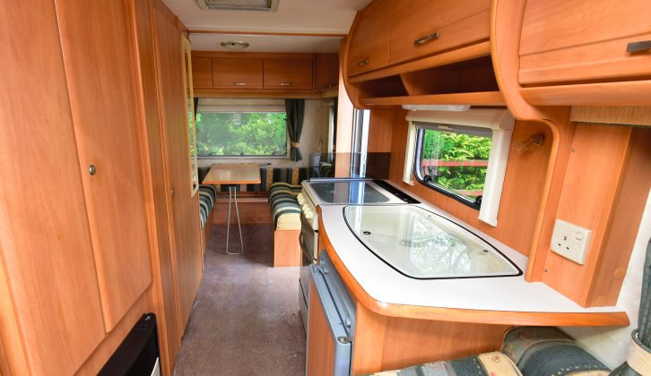 The rear dinette can be left as a double bed if needed, or a fold-up rear bunk adds a fifth berth