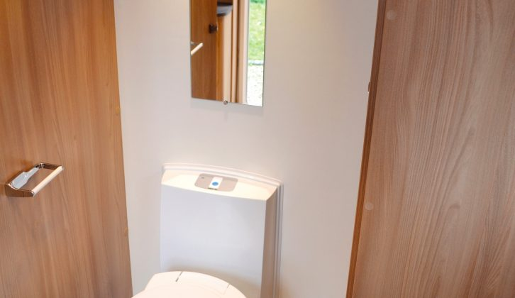 The offside loo sits in front of a handy mirror and alongside a wardrobe with two shelves