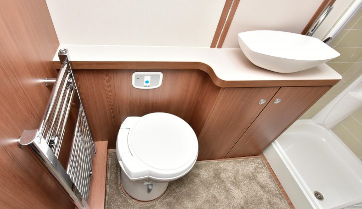 The washroom isn't particularly large, but it includes a salad-bowl washbasin, a heated towel rail and a Thetford cassette loo with a concealed cistern