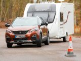 The 3008's body leans a bit and the steering is light, but there was never any sense that the car was being overwhelmed by the caravan