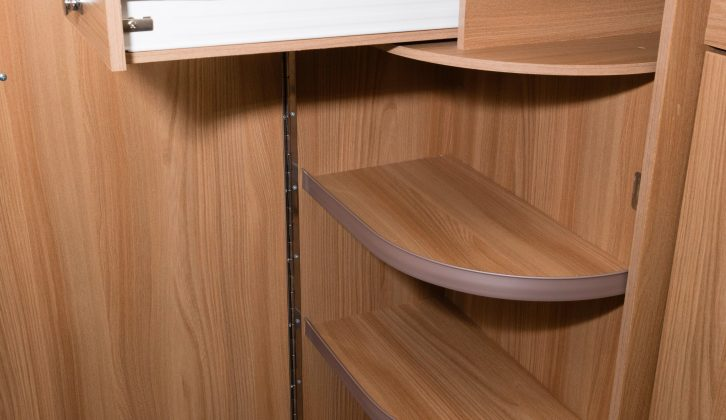The neat, curved door opens to reveal a trio of shelves and a cutlery drawer