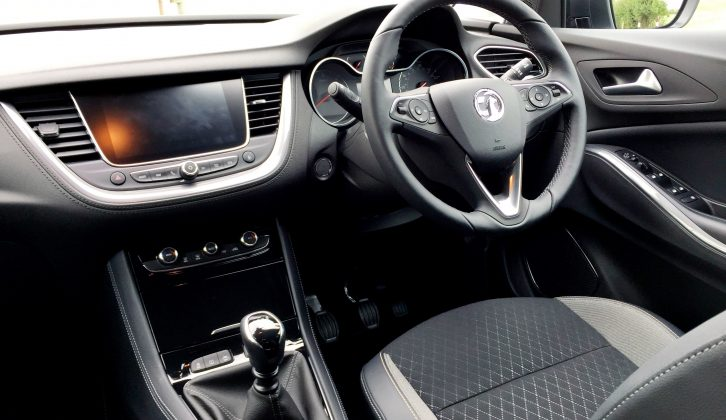 The cabin is intuitive to use, but we're unsure about this model's leather-and-fabric upholstery