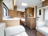The kitchen is sited in the centre of the caravan – drop-in carpets are included in UK models