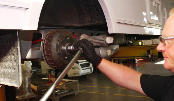 Al-Ko service engineer Ian Forsyth removes the one-shot hub nut