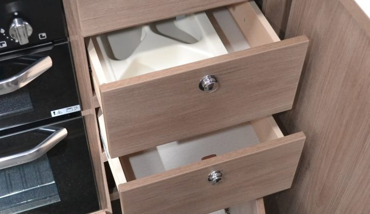 The upper of the drawers under the sink has a cutlery tray