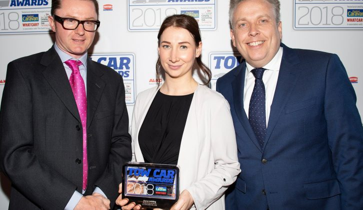 Škoda's Michelle Henniker collects the award for the best car weighing up to 1400kg - the Škoda Octavia Hatch - in the Tow Car Awards 2018, from Practical Caravan's editor, Niall Hampton, and co-host James Cannon