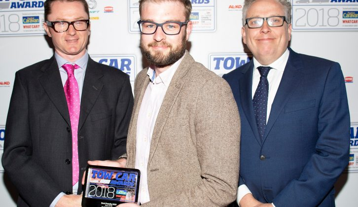 Volvo's Ben Foulds collects the Best Family SUV award for the Volvo XC40 at the Tow Car Awards 2018, from Practical Caravan's editor, Niall Hampton, and co-host James Cannon