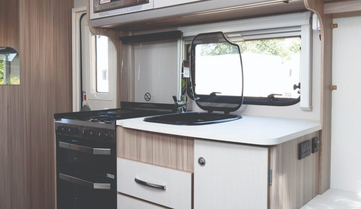 The well-equipped kitchen is compact but makes good use of the space available