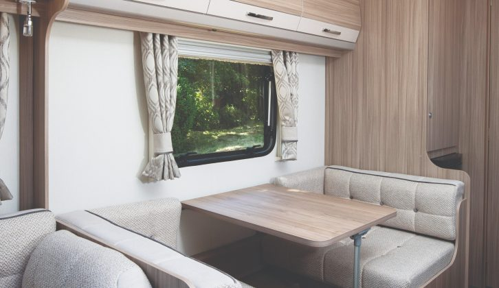 Opposite the kitchen is a comfortable side dinette