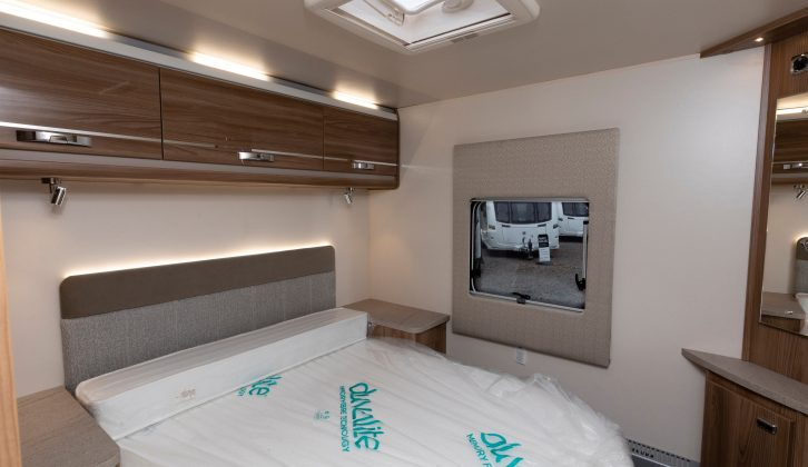 The larger headboard for the rear island bed is also illuminated in this Dealer Special. There's also a second TV point and lots of storage space, including under the bed