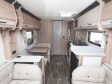 Facing the rear of the caravan, with the dinette creating an occasional bed and the washroom beyond the panelled door