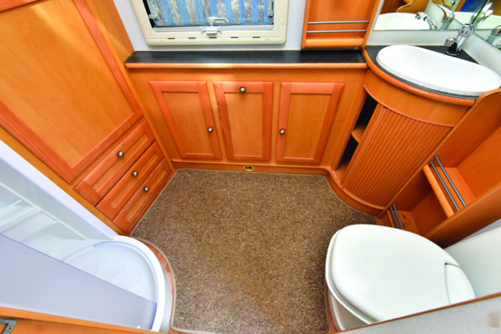 Capacious end washroom offers the added benefit of excellent storage and plenty of room for dressing