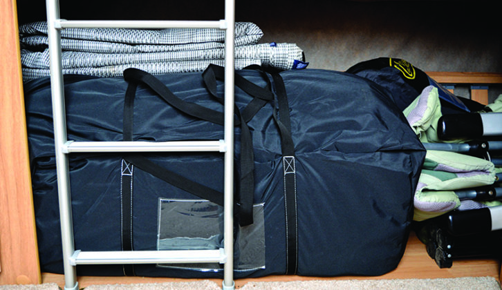 Inflatable packed away in its bag, with awning carpet on top. Awnings are heavy, so keep them near the axle if transporting them in your tourer