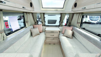 Smart upholstery complements light wood furniture finish